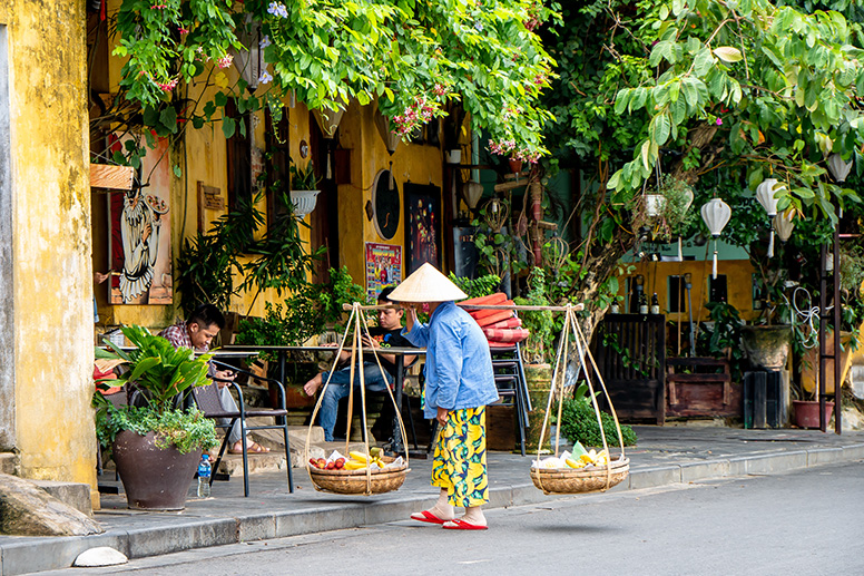 Vietnamese Woman carrying food in Hoi An